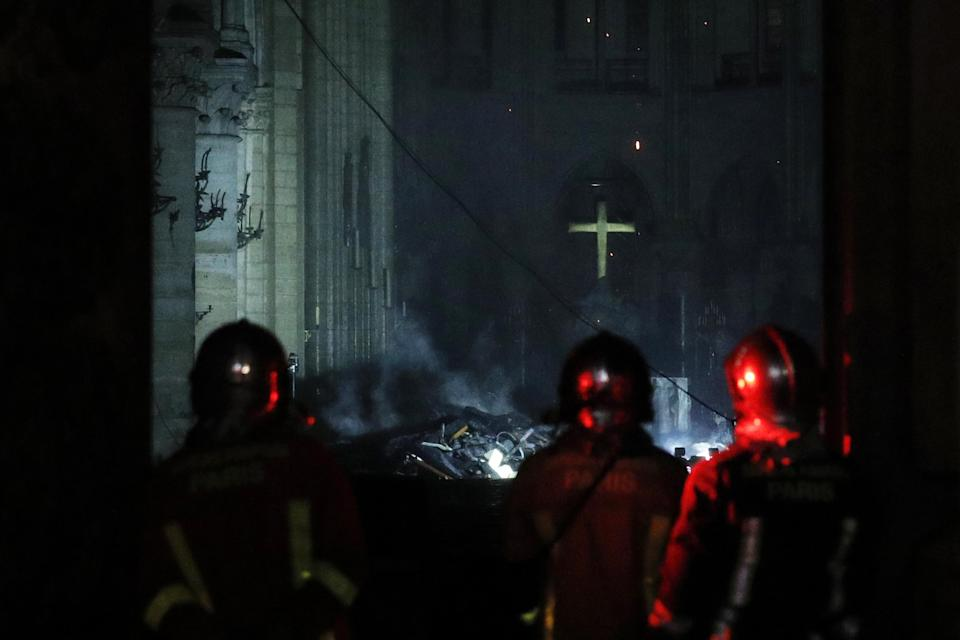 Firefighters gaze at the damage caused.Source: AAP
