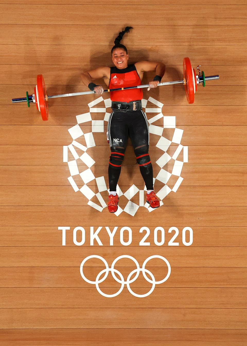 <p>Sema Nancy Ludrick Rivas of Team Nicaragua competes during the Weightlifting - Women's 65kg Group B on day four of the Tokyo 2020 Olympic Games at Tokyo International Forum on July 27, 2021 in Tokyo, Japan. (Photo by Chris Graythen/Getty Images)</p>