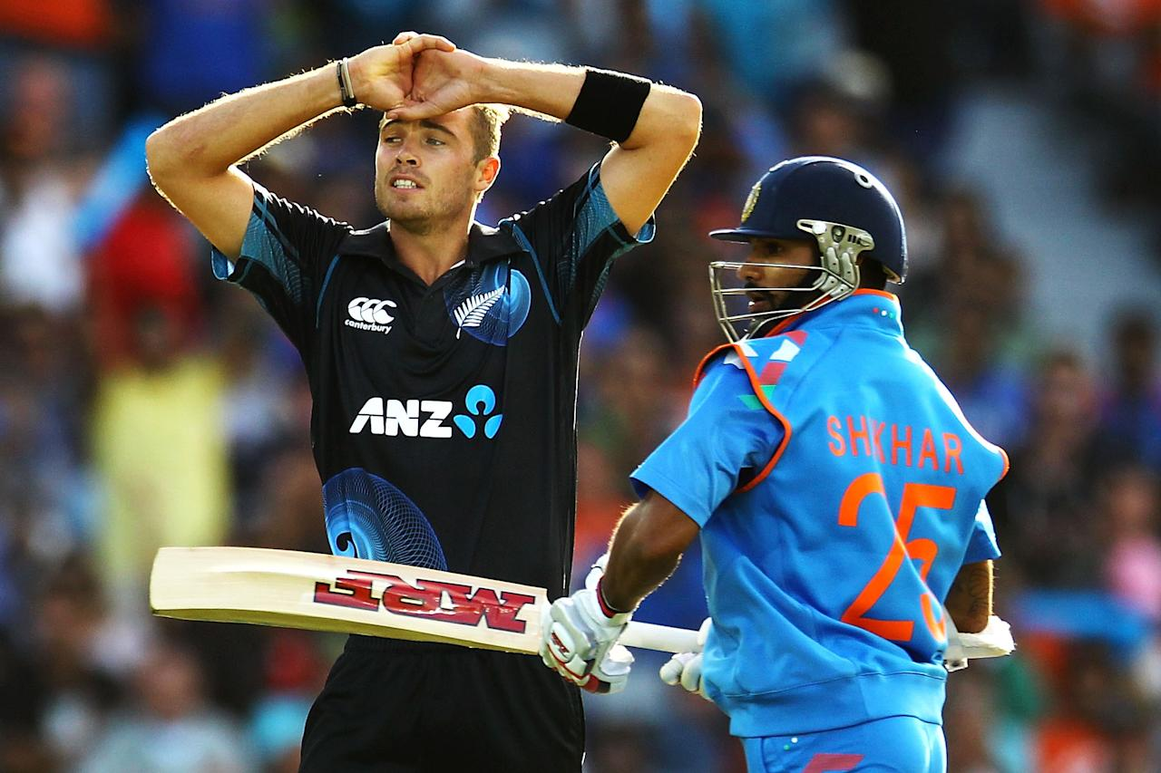 AUCKLAND, NEW ZEALAND - JANUARY 25: Tim Southee of New Zealand reacts as Shikhar Dhawan of India makes his run during the One Day International match between New Zealand and India at Eden Park on January 25, 2014 in Auckland, New Zealand.  (Photo by Anthony Au-Yeung/Getty Images)