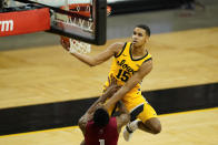 Iowa forward Keegan Murray (15) drives to the basket over Indiana guard Al Durham (1) during the second half of an NCAA college basketball game, Thursday, Jan. 21, 2021, in Iowa City, Iowa. Indiana won 81-69. (AP Photo/Charlie Neibergall)