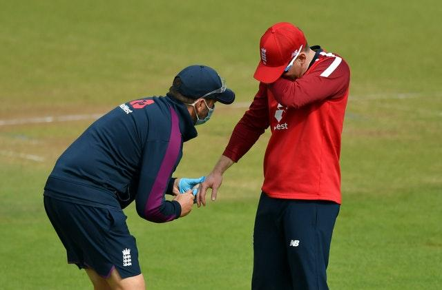 Eoin Morgan (right) suffered a dislocated finger