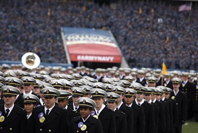 Navy midshipmen stand in formation during the walk-on before the start of the Army-Navy NCAA college football game at Lincoln Financial Field, Saturday, Dec. 14, 2013, in Philadelphia. (AP Photo/Jacqueline Larma)