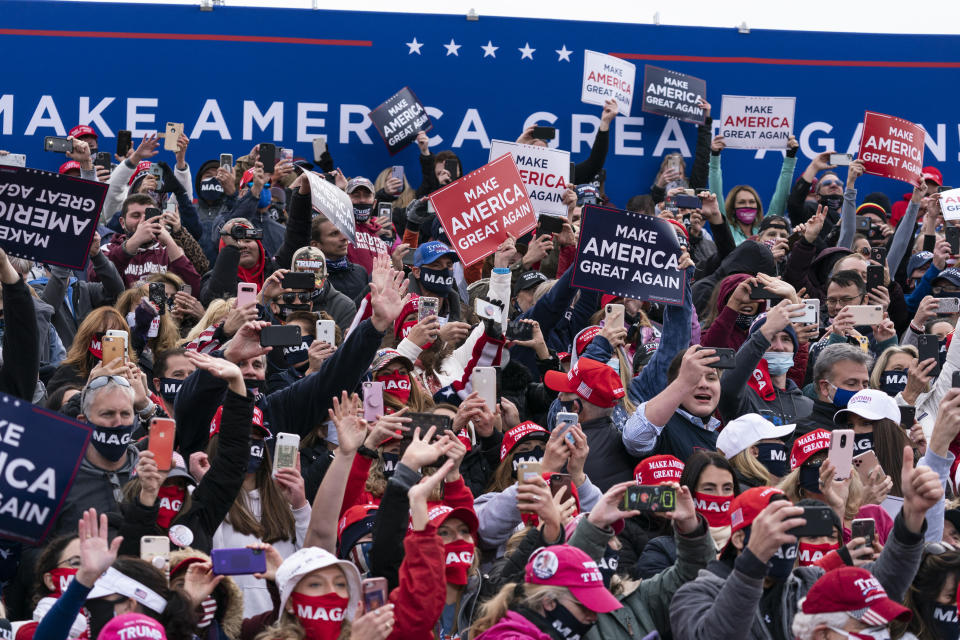 Supporters cheer as President Donald Trump arrives to speak at a campaign rally at Manchester-Boston Regional Airport, Sunday, Oct. 25, 2020, in Londonderry, N.H. (AP Photo/Alex Brandon)