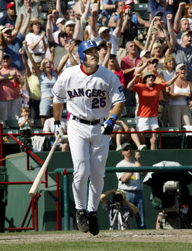 FILE - In this May 11, 2003, file photo, Texas Rangers' Rafael Palmeiro watches as the ball clears the fence after he hit his 500th career home run against the Cleveland Indians in the seventh inning of a baseball game in Arlington, Texas. (AP Photo/Donna McWilliam, File)
