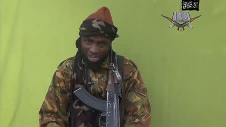 Boko Haram leader Abubakar Shekau speaks at an unknown location in this still image taken from an undated video released by Boko Haram