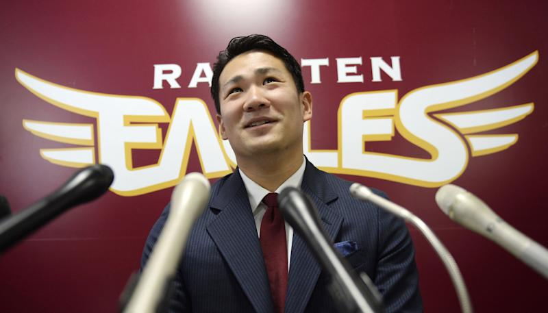 Rakuten Golden Eagles pitcher Masahiro Tanaka speaks at a press conference after a meeting with his club president, in Sendai, northern Japan Tuesday, Dec. 17, 2013. Major League Baseball and Nippon Professional Baseball have finalized a new posting system that caps the fee for players at $20 million, a deal that may lead to star pitcher Tanaka going on the market. (AP Photo/Kyodo News) JAPAN OUT, MANDATORY CREDIT
