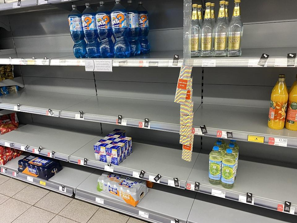 Shoppers have been taking pictures of empty shelves (PA)