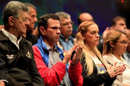 (L-R) Lawmaker of the Venezuelan coalition of opposition parties (MUD) Henry Ramos Allup, Venezuela's opposition leader Henrique Capriles and Lilian Tintori, wife of opposition leader Leopoldo Lopez attend a meeting to present the Frente Amplio Venezuela Libre, a new movement of opposition groups, in Caracas, Venezuela March 8, 2018. REUTERS/Marco Bello