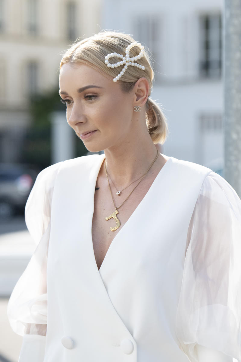 PARIS, FRANCE - JUNE 30: Digital influencer Justyna Czerniak wears a Zaquad jacket, Celine necklace, Chanel earrings and a pearl hair pin on June 30, 2019 in Paris, France. (Photo by Kirstin Sinclair/Getty Images)