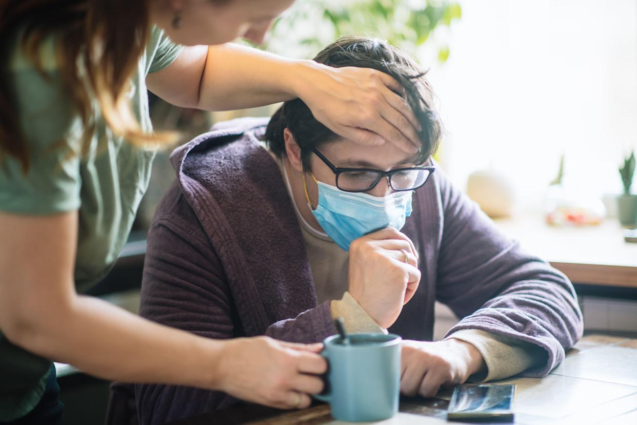 If your partner gets sick with COVID, don't assume you will automatically get infected or hope that you will so you will get it over with. With proper social distancing and sanitization, you can stay healthy. (Photo: ArtMarie via Getty Images)