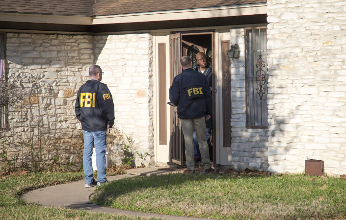 Authorities investigate the scene in East Austin after a teenager was killed and a woman was injured in the second Austin package explosion on March 12, 2018. (Photo: Ricardo B. Brazziell/Austin American-Statesman via AP)