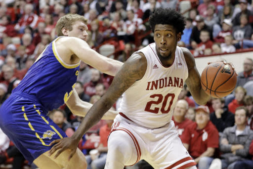 Indiana's De'Ron Davis (20) goes to the basket against South Dakota State's Matt Dentlinger, left, during the first half of an NCAA college basketball game, Saturday, Nov. 30, 2019, in Bloomington, Ind. (AP Photo/Darron Cummings)