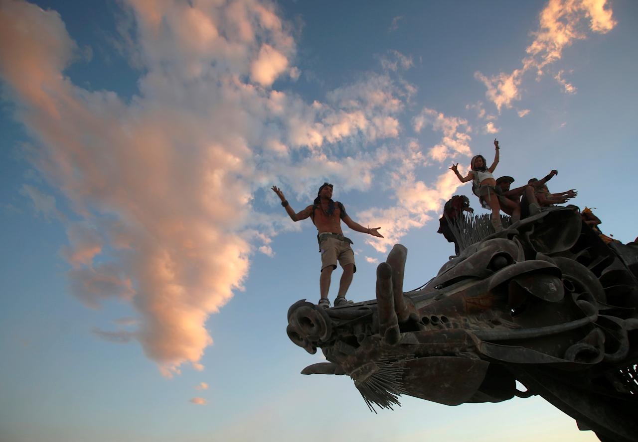 FILE PHOTO -  Participants dance and climb on an art installation as approximately 70,000 people from all over the world gather for the 30th annual Burning Man arts and music festival in the Black Rock Desert of Nevada, U.S. August 31, 2016. REUTERS/Jim Urquhart/File Photo FOR USE WITH BURNING MAN RELATED REPORTING ONLY. FOR EDITORIAL USE ONLY. NOT FOR SALE FOR MARKETING OR ADVERTISING CAMPAIGNS. NO THIRD PARTY SALES. NOT FOR USE BY REUTERS THIRD PARTY DISTRIBUTORS                           REUTERS PICTURES OF THE YEAR 2016 - SEARCH 'POY 2016' TO FIND ALL IMAGES