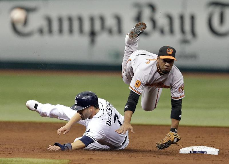 Baltimore Orioles second baseman Alexi Casilla, right, is upended by Tampa Bay Rays' David DeJesus on a double play during the third inning of a baseball game Saturday, Sept. 21, 2013, in St. Petersburg, Fla. The Rays' Ben Zobrist was out at first. (AP Photo/Chris O'Meara)