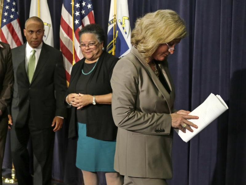 Dr. Madeleine Biondolillo, Director of the Mass. Bureau of Healthcare Safety, right, leaves at the conclusion of a news conference regarding the Massachusetts pharmacy responsible for the meningitis outbreak during a news conference at the Statehouse in Boston, Tuesday, Oct. 23, 2012. The outbreak of meningitis, an inflammation of the lining of the brain and spinal cord, has sickened nearly 300 people, including 23 who died, in more than a dozen states. From left are Mass. Gov. Deval Patrick, Mass. Health and Human Services Secretary JudyAnn Bigby and Biondolilo. (AP Photo/Charles Krupa)