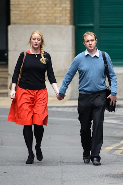 British trader Tom Hayes (R) arrives at Southwark Crown court with his wife Sarah in London on July 27, 2015 (AFP Photo/Leon Neal)