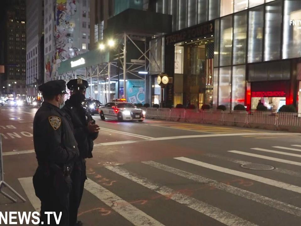 <p>Mr Trump's reported arrival at Trump Tower in New York on Sunday</p> (FreedomNews.TV / YouTube)