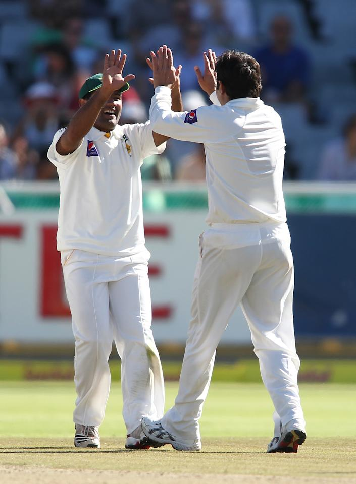CAPE TOWN, SOUTH AFRICA - FEBRUARY 15: Saeed Ajmal of Pakistan is congratulated for getting Hashim Amla of South Africa wicket during day 2 of the 2nd Sunfoil Test match between South Africa and Pakistan at Sahara Park Newlands on February 15, 2013 in Cape Town, South Africa. (Photo by Shaun Roy/Gallo Images/Getty Images)