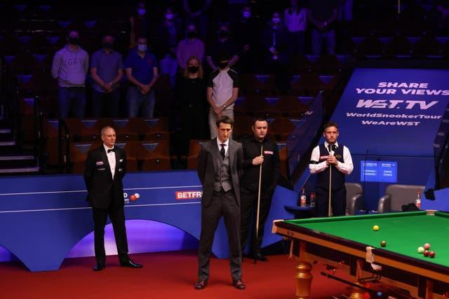 Presenter Rob Walker, Stephen Maguire, Jamie Jones and spectators observed a minute's silence at the Crucible