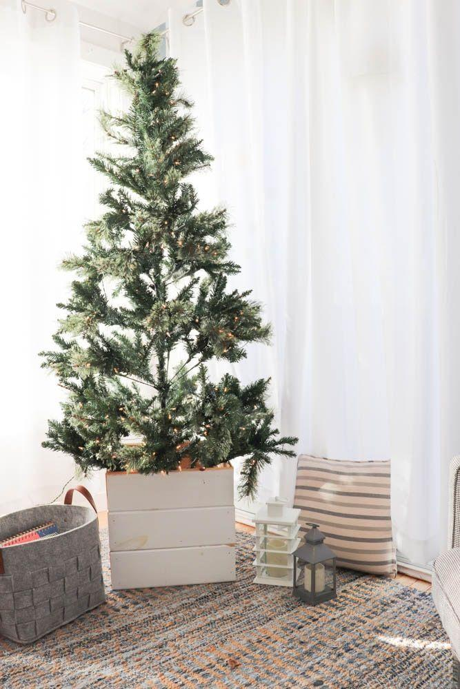 "<p>This easy-to-build stand, fashioned from tongue and groove wood, lends a sense of elegance to any artificial tree. Keep the tree's decor simple, and let your <a href=""https://www.countryliving.com/life/a41187/what-is-hygge-things-to-know-about-the-danish-lifestyle-trend/"" rel=""nofollow noopener"" target=""_blank"" data-ylk=""slk:hygge"" class=""link rapid-noclick-resp"">hygge</a> vibe shine!</p><p><strong>Get the tutorial at <a href=""https://www.diypassion.com/2018/11/09/how-to-make-a-diy-christmas-tree-stand-cover/"" rel=""nofollow noopener"" target=""_blank"" data-ylk=""slk:DIY Passion"" class=""link rapid-noclick-resp"">DIY Passion</a>. </strong></p><p><a class=""link rapid-noclick-resp"" href=""https://go.redirectingat.com?id=74968X1596630&url=https%3A%2F%2Fwww.homedepot.com%2Fp%2F1-in-x-6-in-x-12-ft-Pine-Board-Pattern-Tongue-and-Groove-1612WP4ECB%2F304275598&sref=https%3A%2F%2Fwww.countryliving.com%2Fdiy-crafts%2Fg28746492%2Fdiy-christmas-tree-stands%2F"" rel=""nofollow noopener"" target=""_blank"" data-ylk=""slk:SHOP TONGUE-AND-GROOVE PINE BOARDS"">SHOP TONGUE-AND-GROOVE PINE BOARDS</a></p>"