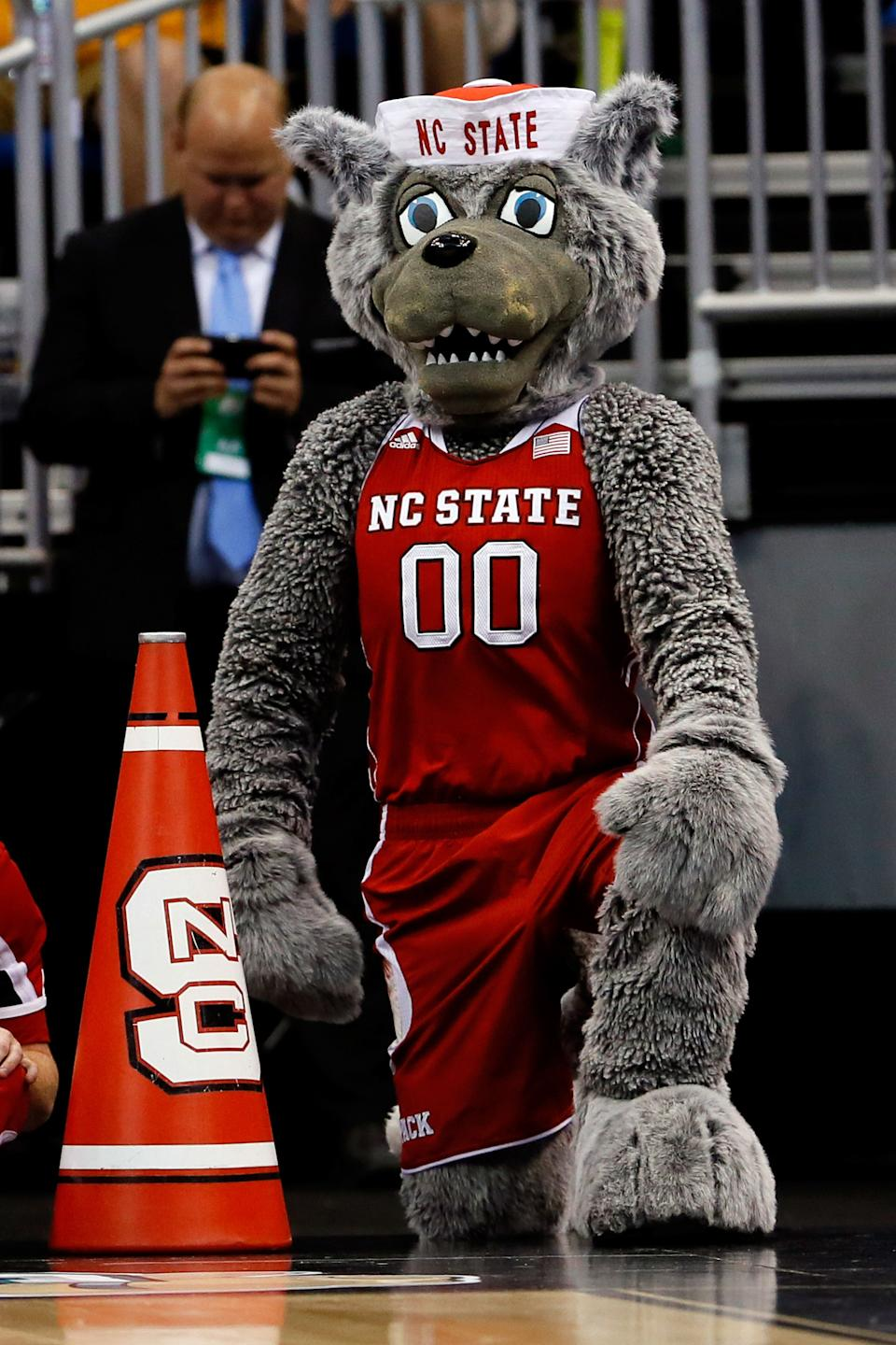 ORLANDO, FL - MARCH 20:  North Carolina State Wolfpack mascot cheers against the Saint Louis Billikens during the second round of the 2014 NCAA Men's Basketball Tournament at Amway Center on March 20, 2014 in Orlando, Florida.  (Photo by Kevin C. Cox/Getty Images)