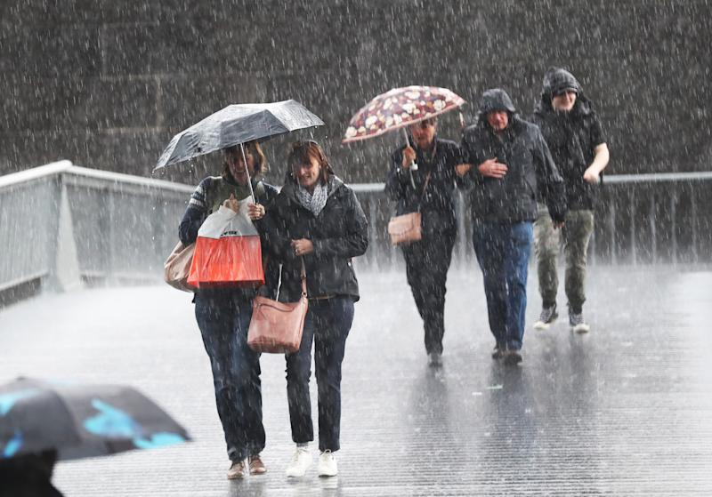 Pedestrians in Melbourne during a shower. The city will have some rain before clear, dry conditions this week. Source: AAP
