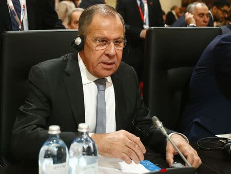Russia's Foreign Minister Lavrov prepares for the beginning of a meeting of OSCE Foreign Ministers in Vienna