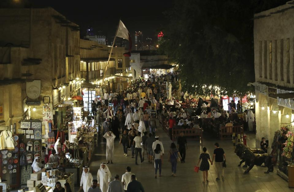 FILE - In this Monday, May 13, 2019 file photo, people walk at Souq Waqif in Doha, Qatar. Qataris awoke to a surprise blockade and boycott by Gulf Arab neighbors 3 1/2 years ago, and this week were jolted again by the sudden announcement that it was all over. (AP Photo/Kamran Jebreili, File)
