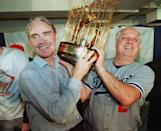 Los Angeles Dodgers manager Tommy Lasorda, right, and Fred Claire, Dodger Vice President hoist the World Series trophy following their team's decicisve 5-2 win over the Oakland A's Oct. 20,1988. (AP Photo/stf)