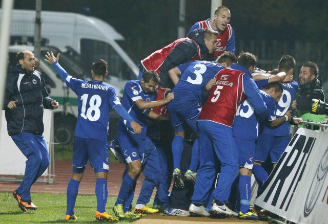 Bosnia's players celebrate a goal during the World Cup group G qualifying soccer match between Lithuania and Bosnia in Kaunas, Lithuania, Tuesday, Oct. 15, 2013. (AP Photo/Mindaugas Kulbis)