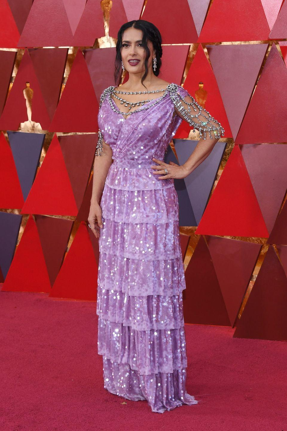 <p>The jewels on Salma Hayek's lavender sequin gown she wore to the Oscars in 2018 remind us of the <em>Hercules </em>princess. Salma even styled her hair with wavy tendrils just like Meg's. </p>