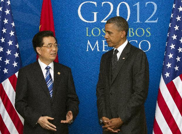 China's President Hu Jintao speaks as President Barack Obama listens during a bilateral meeting during the G20 Summit, Tuesday, June 19, 2012, in Los Cabos, Mexico. (AP Photo/Carolyn Kaster)