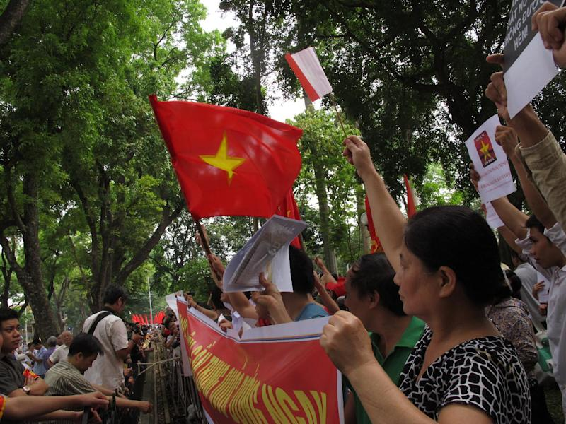 Vietnamese protesters stage a rally against Beijing's deployment of an oil rig in the contested waters of the South China Sea, outside the Chinese Embassy on Sunday, May 11, 2014 in Hanoi, Vietnam. The deployment of the rig has a triggered a tense standoff in the ocean and raised fears of confrontation between the neighboring countries. (AP Photo/Chris Brummitt)