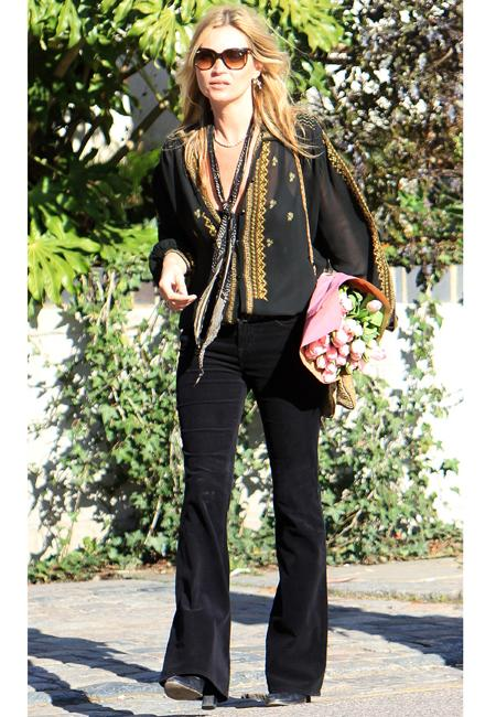 Celebrity fashion: Kate Moss provided a perfect example of how to make black anything but boring. Her sheer shirt complete with gold stitching stole the style show.  We wish we had her wardrobe!