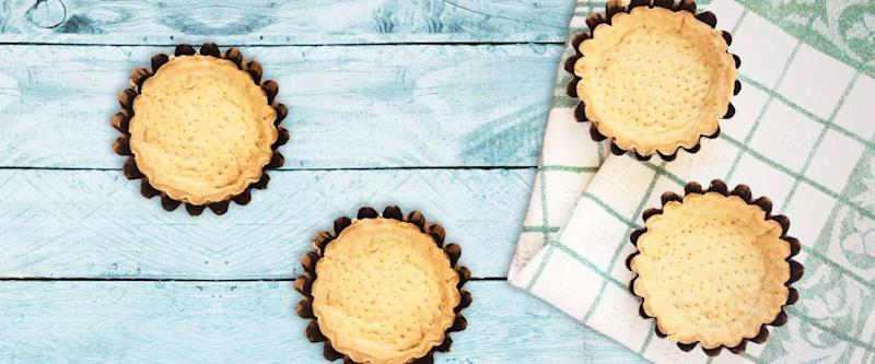 pie shells on a table