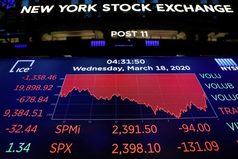 A screen displays trading information over the floor of the New York Stock Exchange (NYSE) in New York