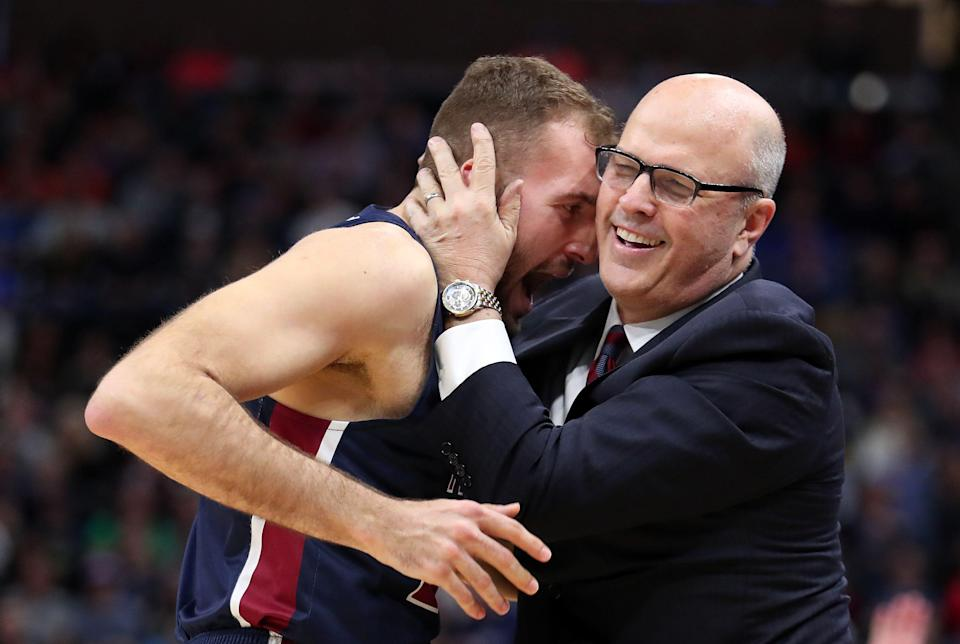 SALT LAKE CITY, UTAH - MARCH 21: Head coach Greg Herenda of the Fairleigh Dickinson Knights embraces Nadi Beciri #24 of the Fairleigh Dickinson Knights after a basket against the Gonzaga Bulldogs during the second half in the first round of the 2019 NCAA Men's Basketball Tournament at Vivint Smart Home Arena on March 21, 2019 in Salt Lake City, Utah. The Gonzaga Bulldogs won 87-49. (Photo by Tom Pennington/Getty Images)