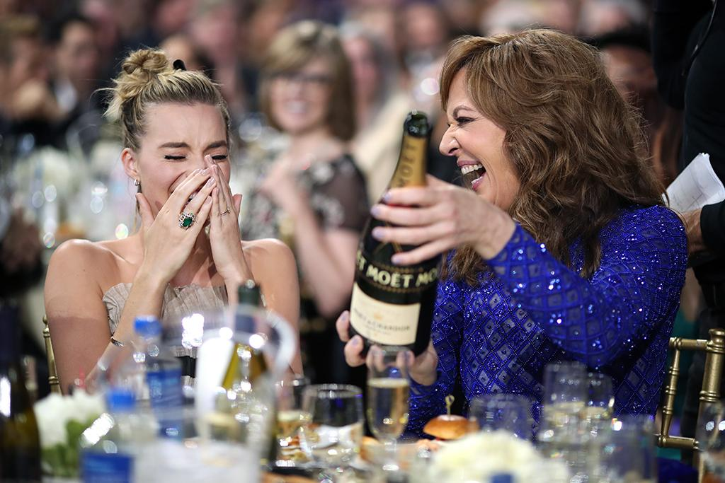 "<p>The <em>I, Tonya</em> stars celebrated with some bubbly, as Robbie took home the statue for Best Actress in a Comedy and Janney for Best Supporting Actress at the the 23rd Annual Critics' Choice Awards on Thursday night. Robbie, who was stunned by her win, told the crowd, ""I was so certain this wasn't going to happen."" (Photo: Christopher Polk/Getty Images for The Critics' Choice Awards ) </p>"