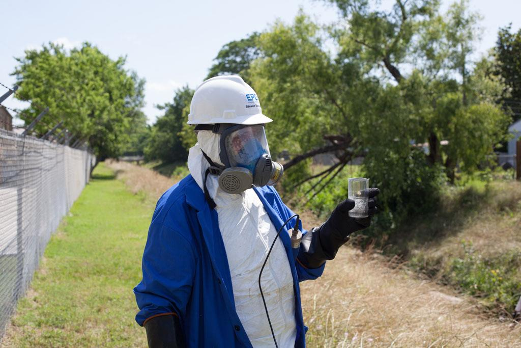 Houston, TX, USA - Steven Vanasse checks for radiation in the local water source.