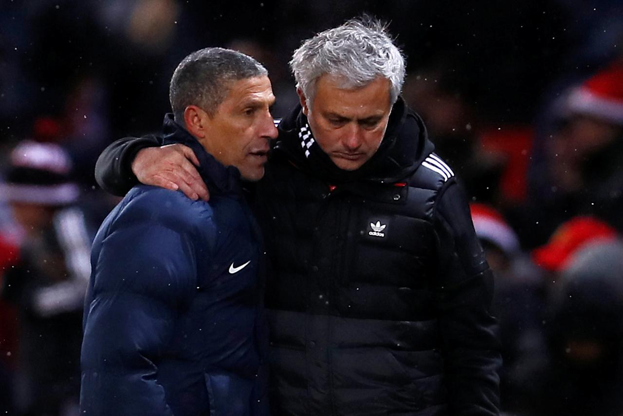 Soccer Football - FA Cup Quarter Final - Manchester United vs Brighton & Hove Albion - Old Trafford, Manchester, Britain - March 17, 2018   Manchester United manager Jose Mourinho with Brighton manager Chris Hughton after the match   Action Images via Reuters/Jason Cairnduff