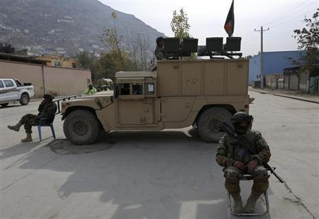 ANA soldiers keep watch near a building in which the Loya Jirga is holding a committee session, in Kabul