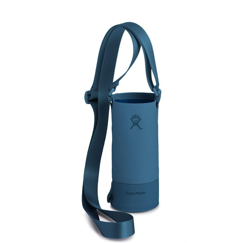 """<p><strong>Hydro Flask</strong></p><p>hydroflask.com</p><p><a href=""""https://go.redirectingat.com?id=74968X1596630&url=https%3A%2F%2Fwww.hydroflask.com%2Fcatalog%2Fproduct%2Fview%2Fid%2F1752%2Fs%2Fhydro-flask-small-tag-along-bottle-sling-lagoon%2Fcategory%2F70%2F&sref=https%3A%2F%2Fwww.runnersworld.com%2Fgear%2Fg32969897%2Fhydro-flask-sale-50-percent-off%2F"""" rel=""""nofollow noopener"""" target=""""_blank"""" data-ylk=""""slk:Shop Now"""" class=""""link rapid-noclick-resp"""">Shop Now</a></p><p><del>$34.95<br></del><strong>$17.48</strong></p><p>Looking for a hands-free way to carry your water bottle during your next run or hike? Check out this sling, which can hold most of Hydro Flask's bottles. </p>"""