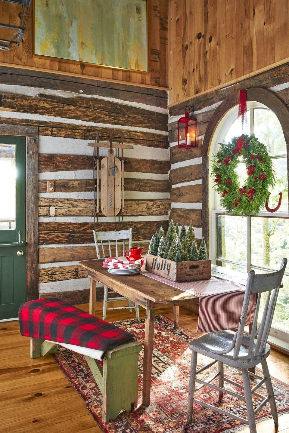 <p>Warm up your home with tons of rustic charm, from buffalo plaid blankets to snow-covered tabletop trees. Round up a dozen or so bottle brush trees in an antique wooden box for an easy centerpiece. </p>