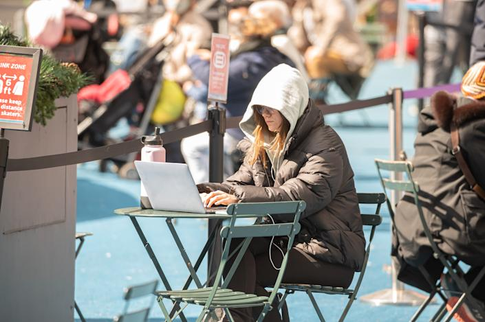 A person works on her laptop at the Bank of America Winter Village in Bryant Park amid the coronavirus pandemic on March 14, 2021 in New York City. (Noam Galai/Getty Images)