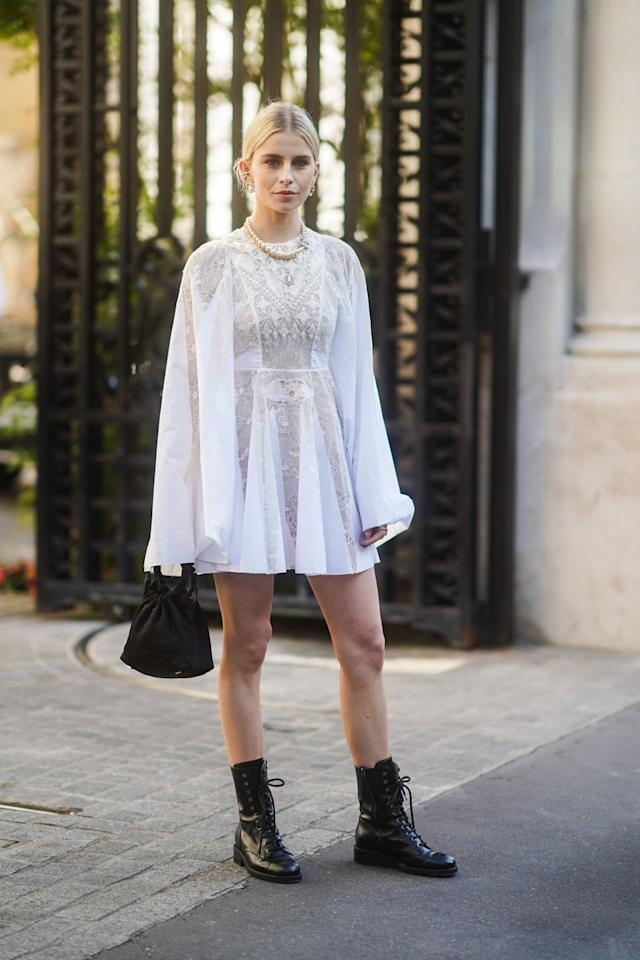 <p>The combat boot is officially back. It serves as the perfect counterpart to ultra-feminine dresses, as seen on Caroline Daur.</p>