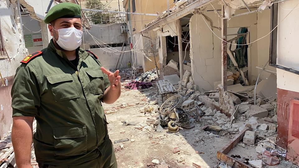 Colonel Mohammed al-Hossein, of the Afrin police, assesses the damage done by a 12 June rocket attack on Al-Shifaa Hospital (Borzou Daragahi)