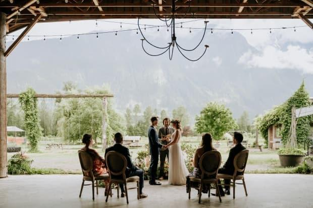 When COVID-19 cancelled all non-essential international travel, Lysiane and Aaron Morris traded their 120-person castle wedding in France for a micro-wedding on North Arm Farm in Pemberton, B.C., with just four guests. (Tara Lilly Photography - image credit)