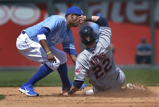 Kansas City Royals shortstop Alcides Escobar, left, tags out Cleveland Indians' Jason Kipnis (22) who was trying to steal second during the third inning of the first of two baseball games onSunday, April 28, 2013, in Kansas City, Mo. (AP Photo/Reed Hoffmann)