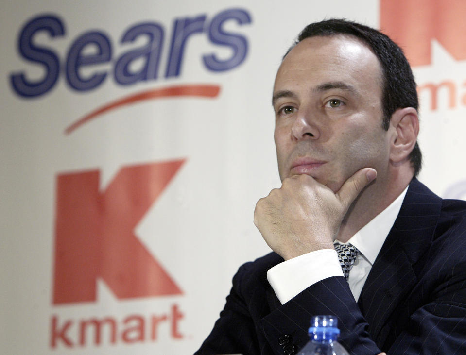 FILE- In this Nov. 17, 2004, file photo Kmart chairman Edward Lampert listens during a news conference to announce the merger of Kmart and Sears in New York. Sears Holdings Corp. is suing its former chairman and largest shareholder Eddie Lampert, alleging the billionaire stripped the once iconic company of more than $2 billion in assets. The lawsuit, which was filed late Wednesday, April 17, 2019. (AP Photo/Gregory Bull, File)
