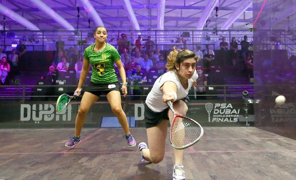 Nour El Sherbini of Egypt (R) plays a backhand against Raneem El Welily during the Dubai PSA World Series Finals squash tournament in Dubai, on May 24, 2016 (AFP Photo/Marwan Naamani)